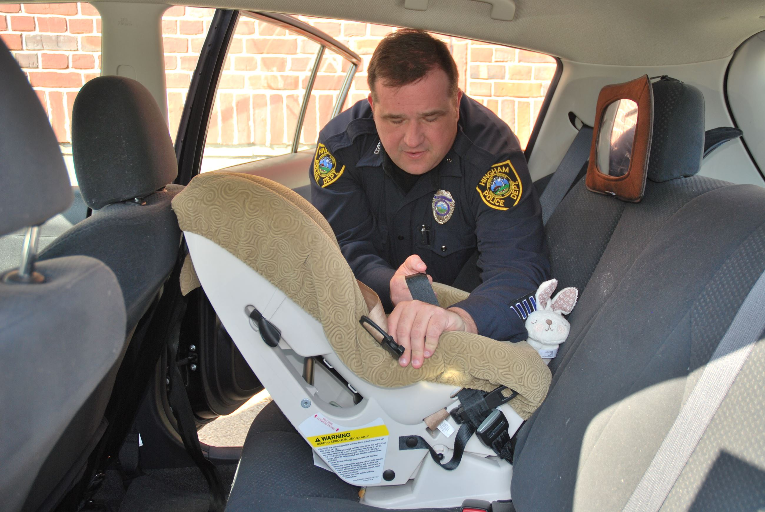 Police Officer Installing Carseat